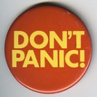 badge saying Don't Panic